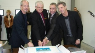 On-hand to cut the cake were: Roger Clarke, executive director, Vehicle Safety and Carrier Services, Alberta Transportation; Richard Warnock, president AMTA; Robert Feagan, director Partners in Injury Reduction, Alberta Employment and Immigration; and Ken Vertz, senior underwriting analyst, WCB.