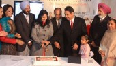 Dara Nagra (fourth from right), president and CEO of Avaal Technology Solutions, cuts the cake during the company's customer appreciation day Dec. 12. Local dignitaries, customers and even Santa Claus made an appearance at the well-attended event.