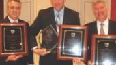 CANADIAN TRIO: Safety reps (l-r): Garth Pitzel (Bison); Tom Boehler (Erb); and Jeff Lehmann (MacKinnon) celebrate their hard-earned awards.