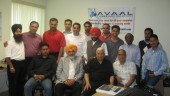 Avaal's latest group of grads poses with special guests after the ceremony in Brampton May 2.