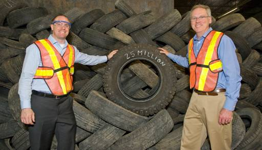 Ontario's Minister of the Environment John Wilkinson (right) celebrates the recycling of 25 million tires in Ontario alongside Andrew Horsman, executive director of Ontario Tire Stewardship.
