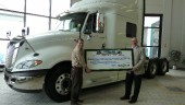 Harry Dornn (right), marketing director with Maxim Truck and Trailer, presents David Northcott, executive director of the Winnipeg Harvest food bank, with a cheque good for 30,000 lbs of food on March 19. Maxim made the donation following a company-wide weight-loss challenge, making a donation for each pound lost by participants.