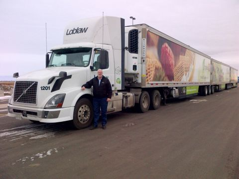 Driver Larry Boyle is pictured the the extra long, long combination vehicle he pulls for Loblaws in Saskatchewan.