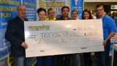 Caravan Logistics presents a cheque for $2,000 to the Trucking for Wishes charity at Truck World on April 21. From left to right: John Iwaniura (president), Ola Iwaniura (project manager), Jayne Gunn (recruiter manager), Bob Workun (vice-president), Helen Thorpe (Caravan city driver), Sonia Merena (inside marketing and sales), and Aaron Lindsay (Trucking for Wishes founder).