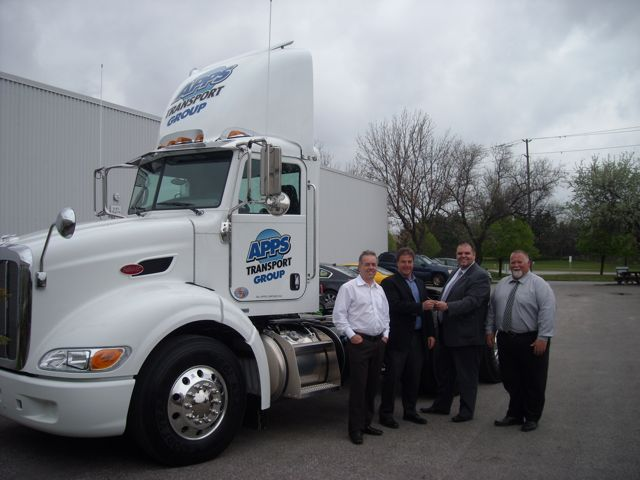 Pictured (L-R): Brent Byers and Rob McDonald of Apps Transport Group with Mark Frias and Dave Farrington, both from Peterbilt Ontario Truck Centres.