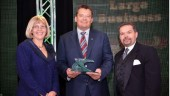 Bison's Rob Penner accepts an award from the Manitoba Chamber of Commerce, recognizing Bison as an Outstanding Large Business.