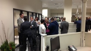Kriska CEO Mark Seymour (far left) mingles with guests at an open house Nov. 21.