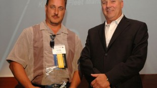Mark Mostacci of TDL Group (left) receives a PMTC-Zurich Private Fleet Safety Award.