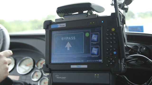 Drivers receive a notification in the cab, indicating whether or not they can drive past the weigh station.